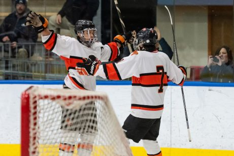 Watertown/Pomperaug's Zachary Smith #7 celebrates with his teammate James Moaddel #29, after scoring to goal to tie the score 1-1, during a Division II Hockey quarterfinal game between WMRP and Watertown/Pomperaug at Trinity College in Hartford on Friday. Bill Shettle Republican-American