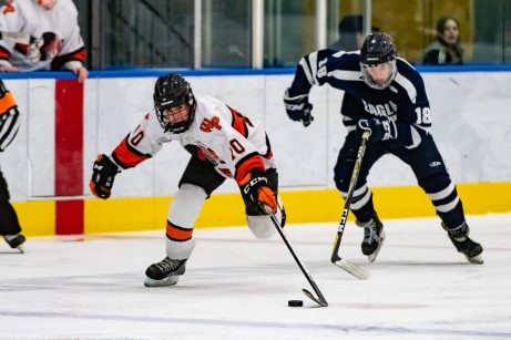 Watertown/Pomperaug's Ryan Magee #10 skates down a puck in front of WMRP's Riordan Mertens #18, during a Division II Hockey quarterfinal game between WMRP and Watertown/Pomperaug at Trinity College in Hartford on Friday. Bill Shettle Republican-American