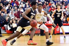 #13 Omar Rowe of Sacred Heart High defends against #45 Quentar Taylor of Trumbull High during the CIAC quarterfinal in Southbury Monday. Steven Valenti Republican-American