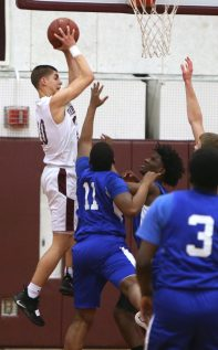 Torrington High School's Joel Villanueva comes down with a rebound during the quarterfinals of the Division III boys varsity basketball tournament in Torrington against West Haven High School on Monday, March 11, 2019. Emily J. Reynolds. Republican-American