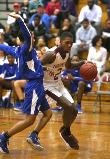 Torrington High School's Ty Davis dribbles past West Haven High School's Tyrese Hargrove during the quarterfinals of the Division III boys varsity basketball tournament in Torrington on Monday, March 11, 2019. Emily J. Reynolds. Republican-American