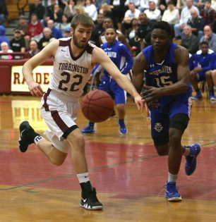 Torrington High School's Kevin Dixon races West Haven High School's Shante Gause during the quarterfinals of the Division III boys varsity basketball tournament in Torrington on Monday, March 11, 2019. Emily J. Reynolds. Republican-American