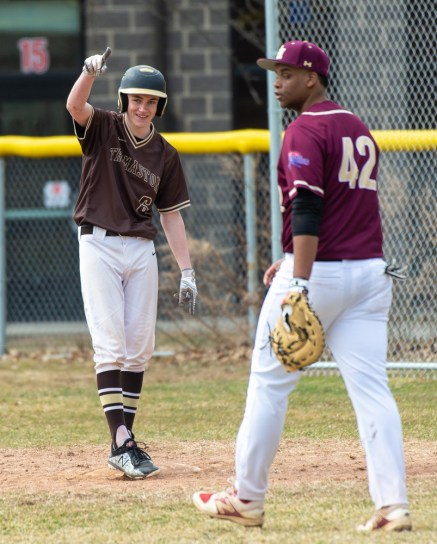 Thomaston's Brendan Fainer (6) celebrates his RBI base hit in front of Sacred Heart's Ernest McClary (42) during their non-league game Saturday at Thomaston High School. Jim Shannon Republican American