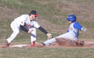 Pomperaug High School's Tyler Goodson tries to tag Seymour High School's #2 at third base during the opening day boys varsity baseball game in Southbury on Monday, April 1, 2019. Emily J. Reynolds. Republican-American