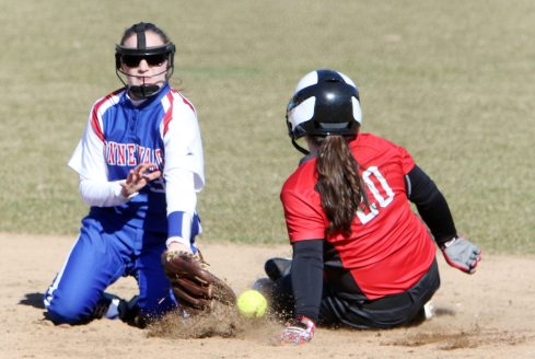#20 Riley Webb of Northwestern Regional High steals 2nd as #32 Julia Lawlor of Nonnewaug High misses the tag during softball action in Woodbury Monday. Steven Valenti Republican-American