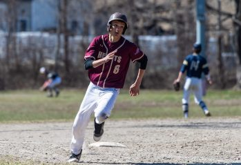 Sacred Heart's Dan Garcia (6) rounds third base on his way to score a run on a two-RBI double by Thaddeus Mercier (17) in the top of the 7th inning of their game against Notre Dame-Fairfield Saturday at Waterville Park in Waterbury. Jim Shannon Republican American