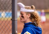 Seymour's Jenna Geffert #1 tries to change the mojo by putting on her rally cap, during the sixth inning of a girls NVL Softball game between St Paul and Seymour at Seymour High School in Seymour on Monday. Bill Shettle Republican-American