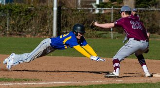 Seymour's Devin Mastrio (22) gets caught too far off first base and was picked off on a tag by Naugatuck's Zack Royka (23) during their game Wednesday at French Memorial Park in Seymour. Jim Shannon Republican American
