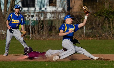 Naugatuck's Mike Patton (7) steals second base after the throw to Seymour's John Chacho (7) was off the mark during their game Wednesday at French Memorial Park in Seymour. Backing up the play is Seymour's Jake Chacho (9) Jim Shannon Republican American