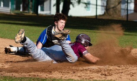 Naugatuck's Derrick Jagello(10) slides in to score on a base hit by Michael Natkiel (8), as he gets past the tag by Seymour's Justin Bennett (11) during their game Wednesday at French Memorial Park in Seymour. Jim Shannon Republican American
