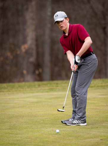 Torrington's Aston Tyler putts on the 14th green during their match with Watertown Thursday at Crestbrook Park in Watertown. Jim Shannon Republican American