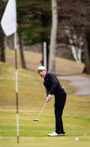 Torrington's Jon Nedda chips to the pin during their match with Watertown Thursday at Crestbrook Park in Watertown. Jim Shannon Republican American