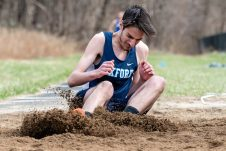 Oxford's Eli Manning lands in the dirt after competing in the long jump, during a a NVL Track and Field meet between Holy Cross, Oxford, and Seymour at Holy Cross High School in Waterbury on Friday. Bill Shettle Republican-American