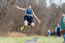 Oxford's Eli Manning flies through the air as he competes in the long jump, during a a NVL Track and Field meet between Holy Cross, Oxford, and Seymour at Holy Cross High School in Waterbury on Friday. Bill Shettle Republican-American
