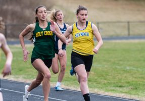 WATERBURY, CT. 12 April 2019-041219 - Holy Cross' Raquel Rosa, left, and Seymour's Patricia Jurkowski are neck and neck as they head for home in the 400 m run, during a a NVL Track and Field meet between Holy Cross, Oxford, and Seymour at Holy Cross High School in Waterbury on Friday. Bill Shettle Republican-American