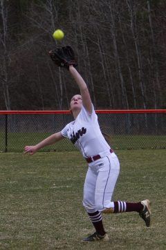 Torrington Lexi Reynolds tries to grab a fly ball against Wolcott Friday afternoon at Torrington. Wolcott won 20-2. Jonathan Wilcox Republican-American