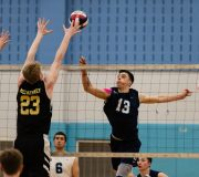 Oxford's Oxford's Patrick Mucherino (13) tips the ball just over the outstretched arms of Joel Barlow's Finn McCaffrey (23) during their match Monday at Oxford High School. Jim Shannon Republican American