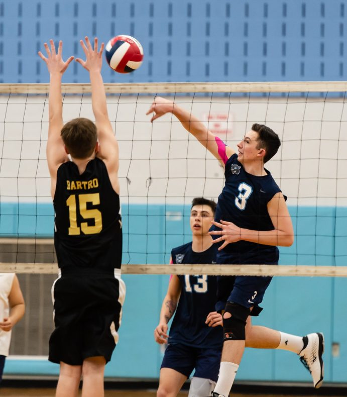 Oxford's Ryan Reynolds (3) spikes the ball past Joel Barlow's Sam Bartro (15) during their match with Joel Barlow Monday at Oxford High School. Jim Shannon Republican American