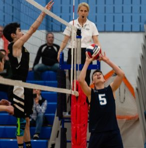 Oxford's Colin Speaker (5) sets the ball at the net in front of Joel Barlow's Rhys Robichaud (8) during their match Monday at Oxford High School. Jim Shannon Republican American