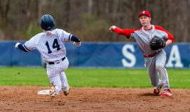 Northwestern's Mike Bobinski (4) throws to first to complete a double play after getting Shepaug's Mike McClusky (14) out at a force play at second base during their game Thursday at Tex Alex Field in Washington. Jim Shannon Republican American