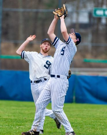 Shepaug's Jack Pesce (28) left, backs off as teammate (13) calls for a the pop-up during their game against Northwestern Thursday at Tex Alex Field in Washington. Jim Shannon Republican American