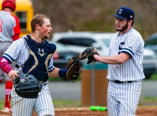 Shepaug relief pitcher Chance Dutcher (18), right, is congratulated by catcher Ethan Hibbard (3) after getting out a bases-loaded jam in the sixth inning of their game against Northwestern Thursday at Tex Alex Field in Washington. Jim Shannon Republican American