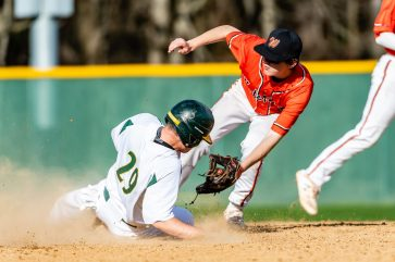 Holy Cross' Austin Brown #29, left, slides safely into second ahead of throw to Watertown's John Biolo #1, during a Boys NVL Baseball game between Holy Cross and Watertown at Municipal Stadium in Waterbury on Tuesday. Holy Cross won 11-1. Bill Shettle Republican-American