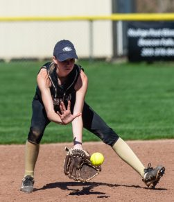 Woodland's Steph Krebbs (2) scoops up a ground ball during their NVL match-up with Seymour Wednesday at the Beacon Falls Recreational Complex. Jim Shannon Republican American
