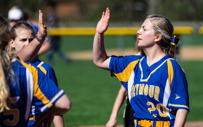 Seymour's Molly Adamo (20) is congratulated by teammates after pitching out of a jam during their NVL match-up with Woodland Wednesday at the Beacon Falls Recreational Complex. Jim Shannon Republican American