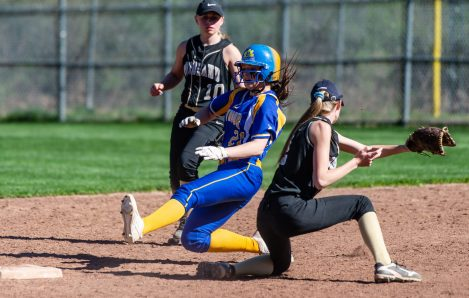 Seymour's Morgan Teodosio (21) slides safely into second base in front of the tag by Woodland's Steph Krebbs (2) during their NVL match-up Wednesday at the Beacon Falls Recreational Complex. Jim Shannon Republican American