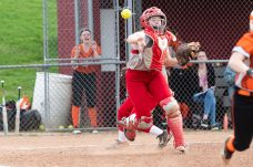 Wolcott catcher Lexi Boyce #13 picks up a live ball at home plate and throws to first base for an out, during a NVL Girls softball game between Terryville and Wolcott at Wolcott High School in Wolcott on Thursday. Bill Shettle Republican-American