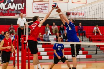 Lewis Mill's Nick Jennings #25, right, and Cheshire's Conor Guilford #22 meet at the net, during a boys volleyball match between Lewis Mills and Cheshire at Cheshire High School in Cheshire on Friday. Bill Shettle Republican-American
