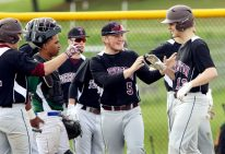 #13 James Gaskin of Torrington High, right, is greeted by #5 Kyle Banche of Torrington and fellow teammates after hitting a home run against Wilby High during NVL baseball action in Waterbury Monday. Steven Valenti Republican-American