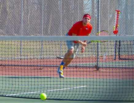 Wolcott's Kevin Quinn fires an ace in NVL tennis action on Tuesday. (Palladino/RA)