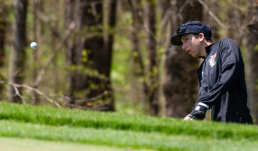 Pomperaug's Zachary Wisnefsky chips his shot onto the green during the Woodland Individual golf tournament held Thursday at Oxford Greens in Oxford. 20 schools from throughout the state completed in the tournament. Jim Shannon Republican American