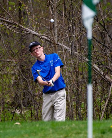 Seymour's Jonah DeJarnette, chips his shot onto the green during the Woodland Individual golf tournament held Thursday at Oxford Greens in Oxford. 20 schools from throughout the state completed in the tournament. Jim Shannon Republican American