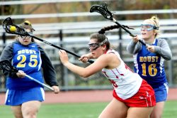 #18 Adriana Ferrucci of Wolcott High keeps the ball from #16 Madison Simonds of Housatonic Regional High during Lacrosse action in Wolcott Thursday. Steven Valenti Republican-American