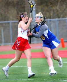 #4 Melony Albert of Wolcott High tries to keep the ball from #16 Madison Simonds of Housatonic Regional High during Lacrosse action in Wolcott Thursday. Steven Valenti Republican-American