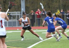 Pomperaug High School's Camden Frissora looks for an open defender during the girls varsity lacrosse game against Fairfield Ludlowe in Southbury on Saturday afternoon. Emily J. Reynolds. Republican-American