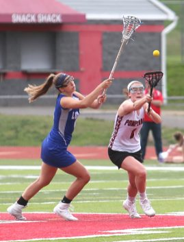 Pomperaug High School's Kathleen Schenk battles for the ball during the girls varsity lacrosse game against Fairfield Ludlowe in Southbury on Saturday afternoon. Emily J. Reynolds. Republican-American