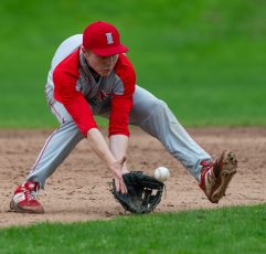 Northwestern's Mike Bobinski (4) scoops up a ground ball to throw to first for the out during their Berkshire League game against Lewis Mills Monday at Northwestern in Winsted. Jim Shannon Republican American