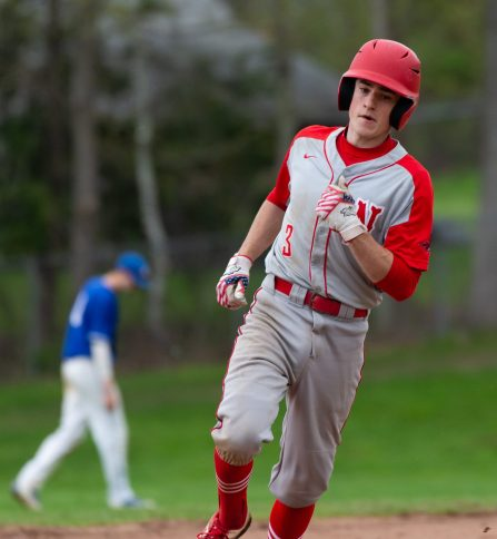 Northwestern's Joey Grantmeyer (3) round third on his way home after blasting a solo home run during their Berkshire League game against Lewis Mills Monday at Northwestern in Winsted. Jim Shannon Republican American