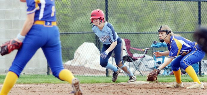 #0 Jenna Myers of Oxford High takes a lead off 3rd as #12 Victoria Sampiere of Seymour High waits for the swing during softball action in Oxford Monday. Steven Valenti Republican-American