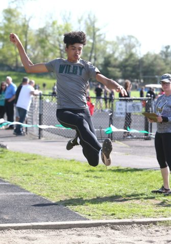 Wilby High School's Leonardo DaGraca jumps 19 feet 11 inches in the long jump during the three school track meet between Wilby, Woodland, and Derby at Woodland Regional High School on Tuesday afternoon. Emily J. Reynolds. Republican-American