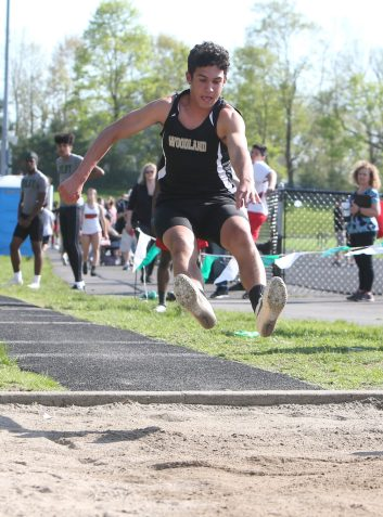 Woodland Regional High School's Luca Cambra competes in the long jump during the three school track meet between Wilby, Woodland, and Derby at Woodland Regional High School on Tuesday afternoon. Emily J. Reynolds. Republican-American