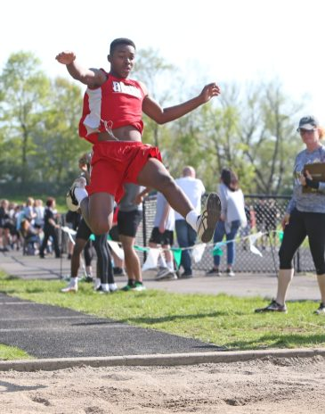 Derby High School's Zyair Wali competes in the long jump during the three school track meet between Wilby, Woodland, and Derby at Woodland Regional High School on Tuesday afternoon. Emily J. Reynolds. Republican-American