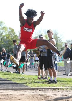 Derby High School's Zerion Montgomery jumps more than 21 feet in the long jump during the three school track meet between Wilby, Woodland, and Derby at Woodland Regional High School on Tuesday afternoon. Emily J. Reynolds. Republican-American