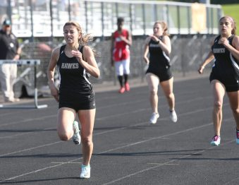 Woodland Regional High School's Julia Accetura wins the second heat of the girls 400 meter race during the three school track meet between Wilby, Woodland, and Derby at Woodland Regional High School on Tuesday afternoon. Emily J. Reynolds. Republican-American
