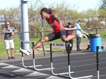 Derby High School's Ja'kwan Hale wins the first heat of the boys hurdles during the three school track meet between Wilby, Woodland, and Derby at Woodland Regional High School on Tuesday afternoon. Emily J. Reynolds. Republican-American
