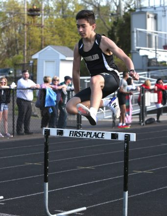 Woodland Regional High School's Nicholas Santovasi wins his heat of the boys hurdles during the three school track meet between Wilby, Woodland, and Derby at Woodland Regional High School on Tuesday afternoon. Emily J. Reynolds. Republican-American